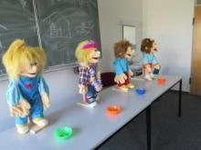 Vier Puppen zur Auswahl